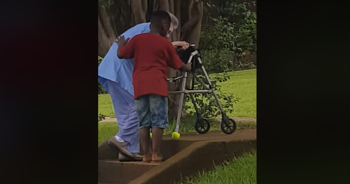 8-Year-Old Boy Filmed Helping Older Woman With Walker To Climb Stairs And It's Too Pure